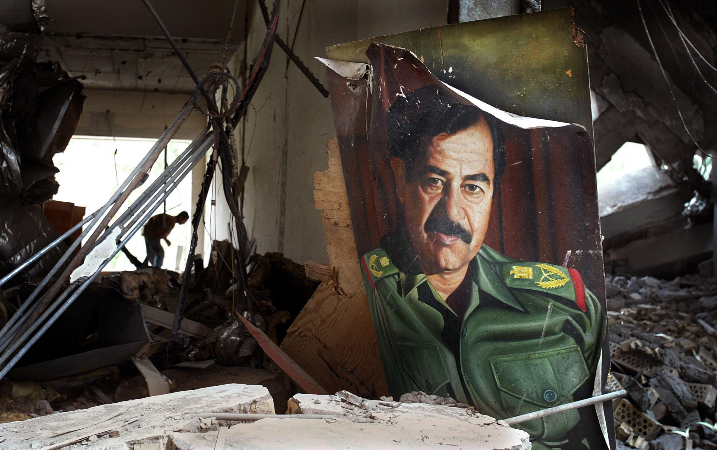 A portrait of Saddam Hussein lies in a bombed government building in April 2003 in Basra, Iraq