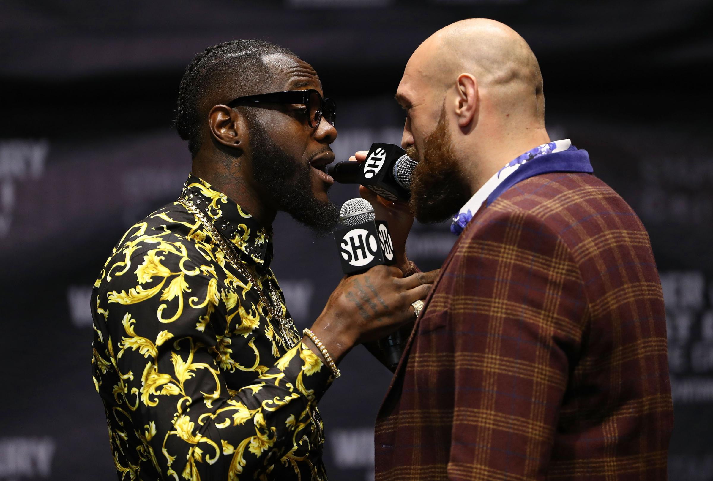LOS ANGELES, CA - OCTOBER 03:  Professional boxers Deontay Wilder (L) and Tyson Fury speak onstage during their press conference to promote their upcoming December 1, 2018 fight in Los Angeles at The Novo by Microsoft on October 3, 2018 in Los Angeles, Ca
