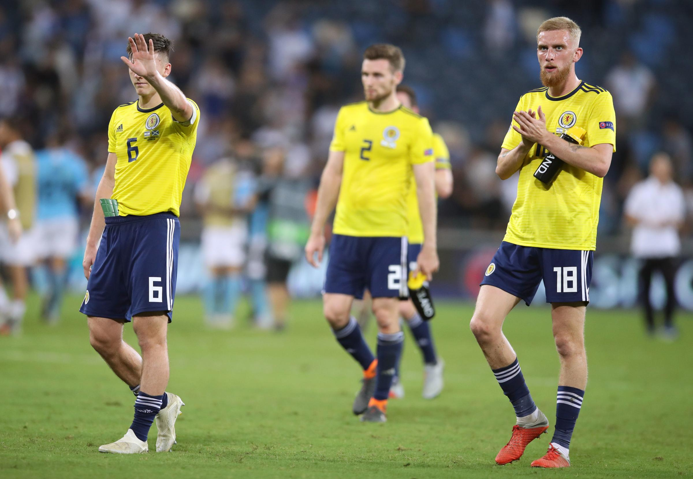 Scotland's Kieran Tierney (left) and Oliver McBurnie acknowledge the fans after the UEFA Nations League Group C1 match at the Sammy Ofer Stadium, Haifa. PRESS ASSOCIATION Photo. Picture date: Thursday October 11, 2018. See PA story SOCCE