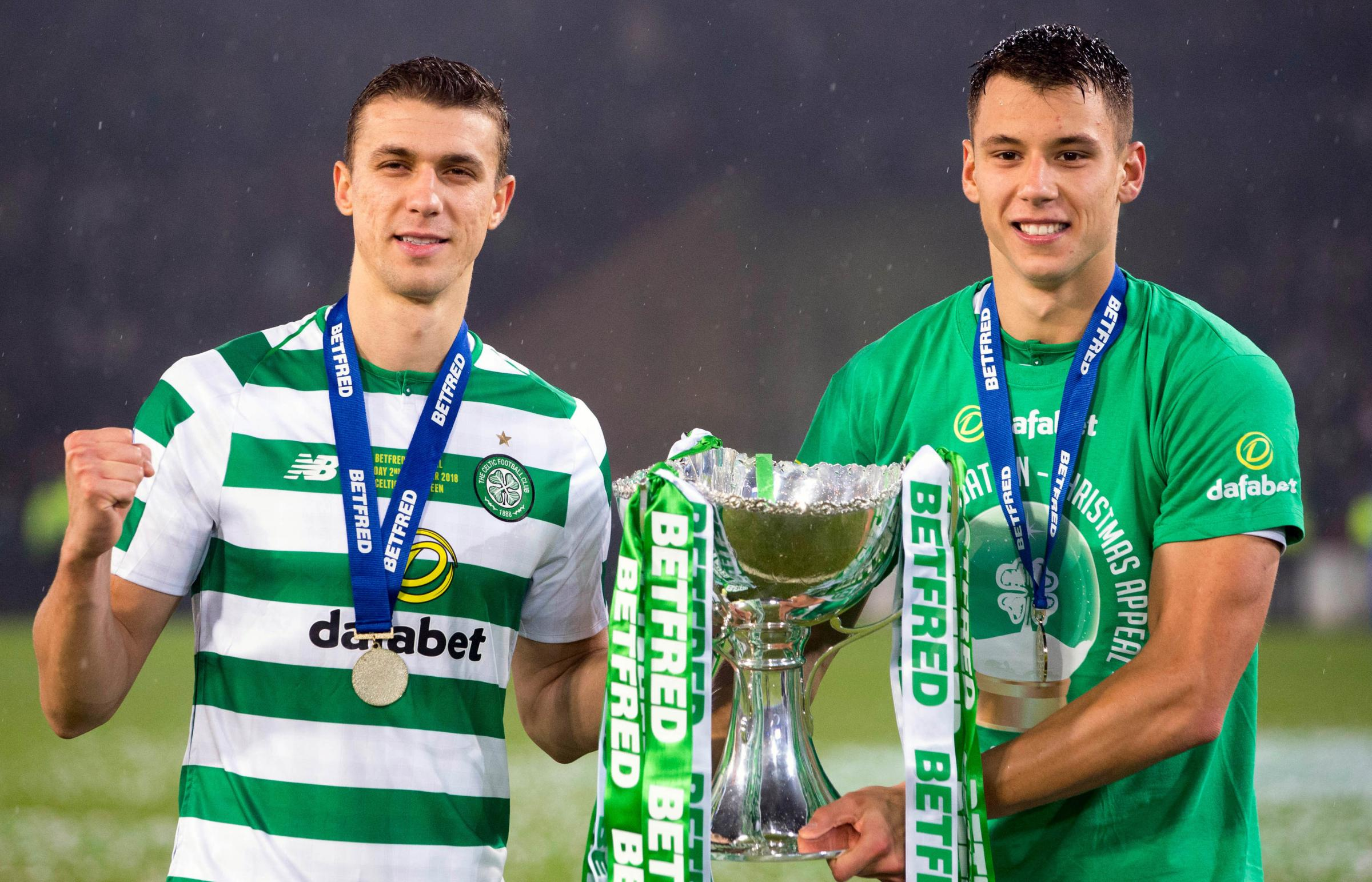Celtic's Jozo Simunovic and Filip Benkovic lift cup during the Betfred Cup Final match at Hampden Park, Glasgow. PRESS ASSOCIATION Photo. Picture date: Sunday December 2, 2018. See PA story SOCCER Final. Photo credit should read: Jeff Holmes/PA Wire.