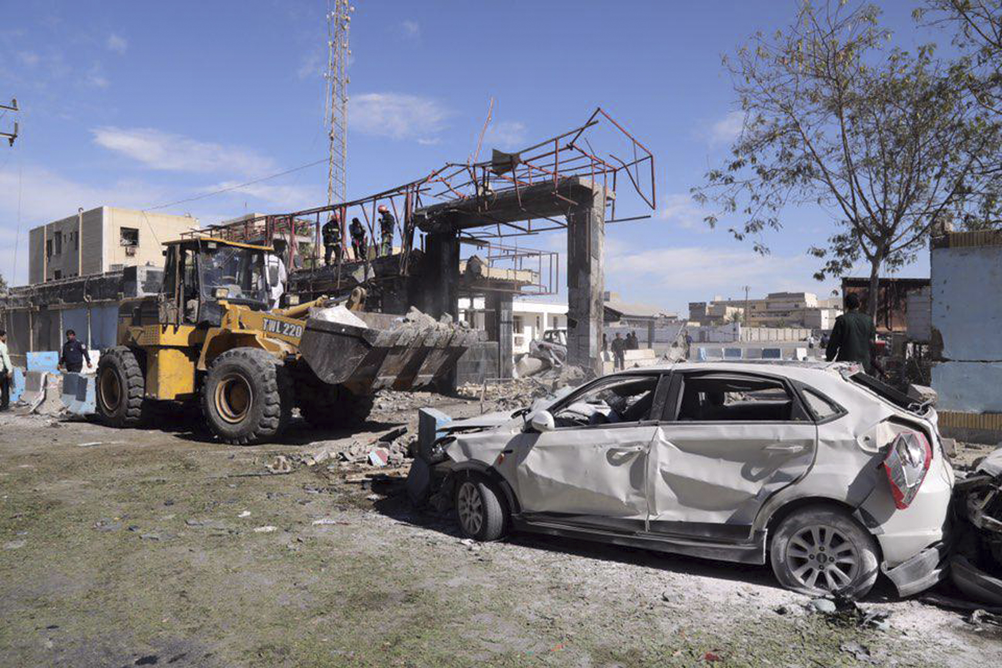 The wreckage of a car after a suicide bombing at the gate of a police headquarters in the south-eastern Iranian port city of Chabahar